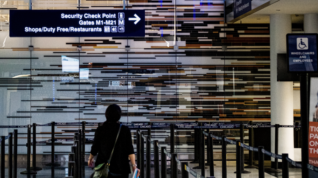 Woman heading towards airport security