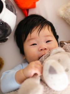 Baby snuggling stuffed animal